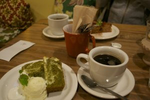 Green tea cake with cream cheese, ice cream and whipped cream, apple cake and organic filtered coffee