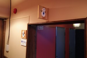 A male snowman sign for the men's toilet