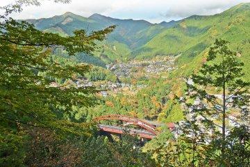 <p>A view of Unzen Bridge and the surrounding landscape below</p>