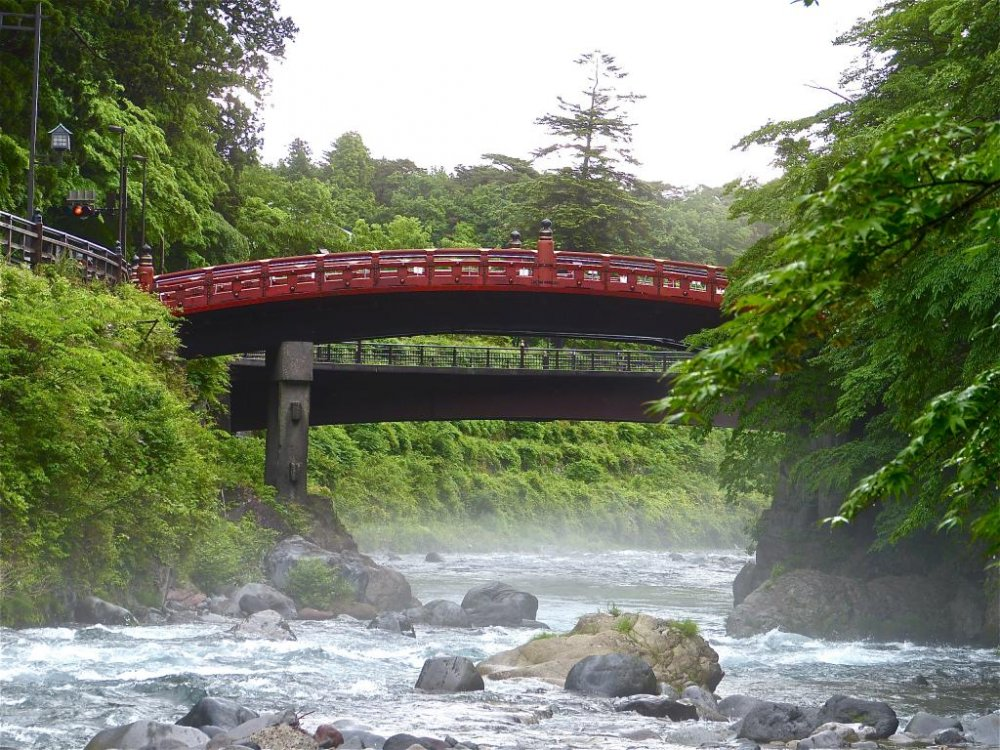 View of Shinkyo Bridge from the riverbank, early in the morning.