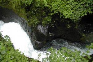 Oketsu (natural big hole in the rocks along a river)