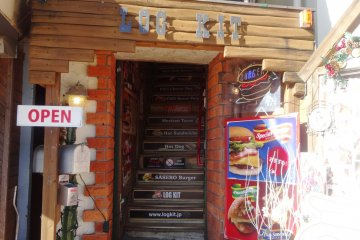 <p>The restaurant is located on the second floor of what is supposed to remind you of a log cabin</p>