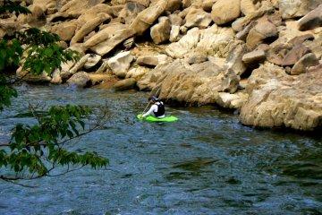 <p>Lone kayaker in a tiny kayak</p>