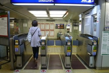 Train ticketing gates - slide your ticket or card into the slot, and it pops out the other side!