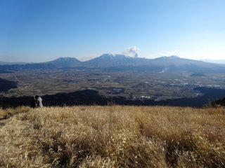 A currently smoking Mt Aso can be seen from the Daikanbo lookout on Aso's scenic Milk Road