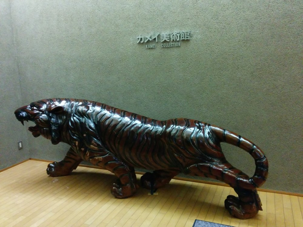 A tiger greets you outside the elevator