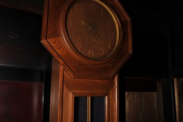<p>Impressive wooden wall clock! It was ticking regularly but I wished time would stop this night!</p>