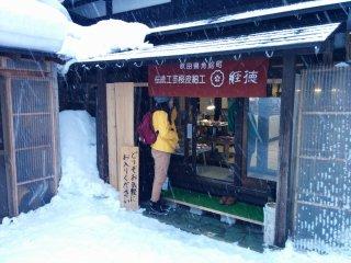 Escaping a sudden snow storm inside a local shop