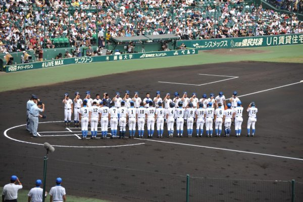 The teams line up and bow to each other before the game begins.