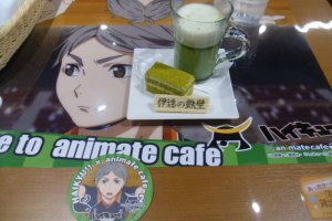 """""""Date's Iron Wall"""", a matcha (green tea) cake set. Each order comes with a collectable coaster."""