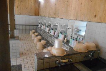 <p>Shower area beside the baths</p>