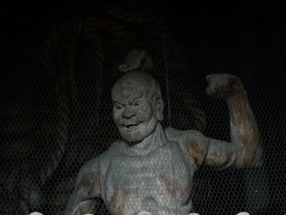 Statue of Nio, muscular guardian of the Buddha, stands just inside the gate