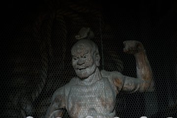 <p>Statue of Nio, muscular guardian of the Buddha, stands just inside the gate</p>