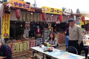 Try some Yakisoba fried noodles and enjoy the open air fun fair atmosphere at the stalls.