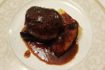 <p>A hamburg steak made from locally sourced venison</p>
