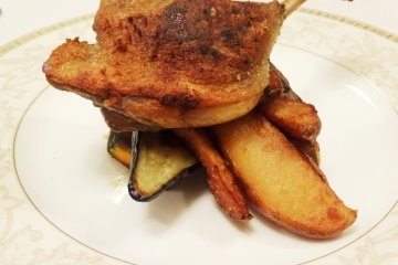 <p>Duck served over a bed of fried potatoes and roasted vegetables</p>