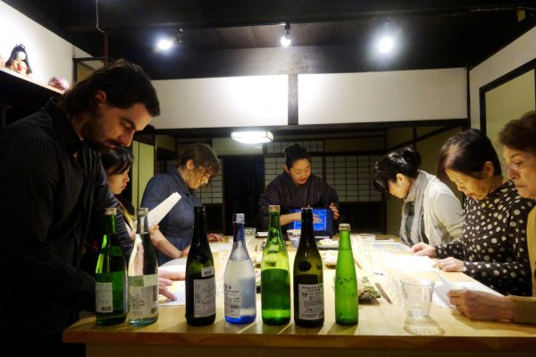 Sake bottles occupy a prominent position on the tasting table at Kafu's sake tasting workshop