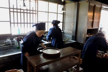<p>A very old-fashioned kitchen at Akafuku Sweets store</p>