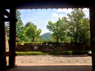 The burrowed view of the distant mountains from the Maizuru Park Gardens