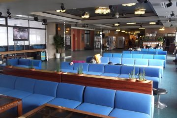 <p>The lounge by reception, where some people evidently like to nap</p>