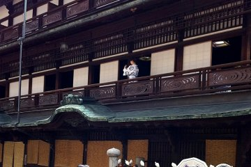 The rippling pool motif of Dogo onsen appears on the balustrades and the bathrobes