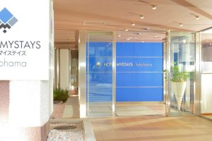The brightly lit entrance of HOTEL MYSTAYS Yokohama