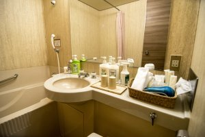 Various amenities are provided for your stay. In the bathroom, a basket full of everything you will need welcomes you to your room.