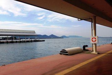 Green wooded islands and inlets surround Takamatsu port.