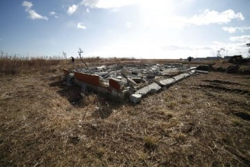 Only housing foundations remained after the Tohoku Earthquake and tsunami, showing how Japan lives side by side with natural disasters
