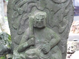 A tombstone, or perhaps the depiction of a deity