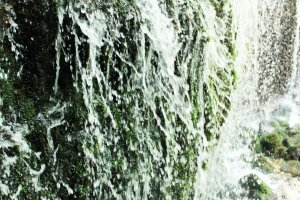 The white threads of the waterfall