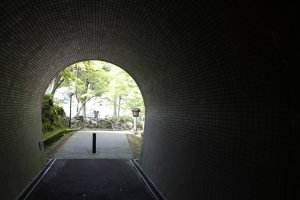 A tunnel going towards the lake and playground.