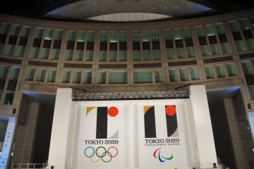 The Olympic and Paralympic emblems, framed by the TMGB.