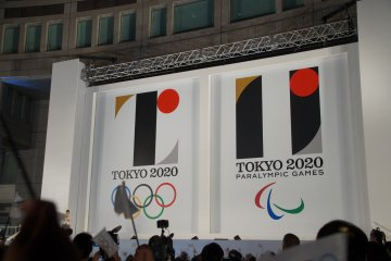 """The big reveal. The Olympic design (left) suggests a 'T'-shape, while the Paralympic emblem (right) symbolizes an """"="""" mark for equality."""