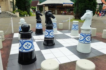 <p>A giant porcelain chess set in the park</p>