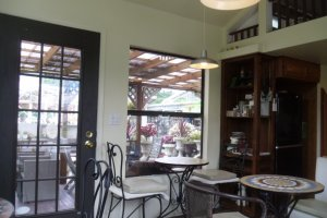 Lovely and bright, but with air conditioning! You can see the outdoor seating area through the window.