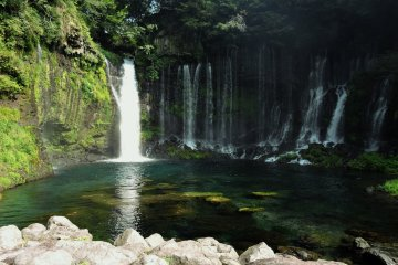 <p>The largest &#39;thread&#39; of the waterfall flows into a small pool</p>