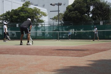 <p>People play tennis on one of the many tennis courts in the park.&nbsp;</p>