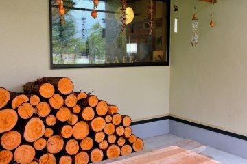 <p>Wood stacked outside the cafe</p>