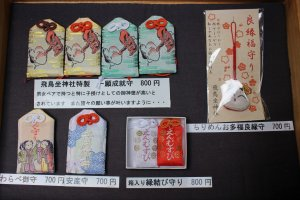 Omamori protective charms with Tengu and Okame on them