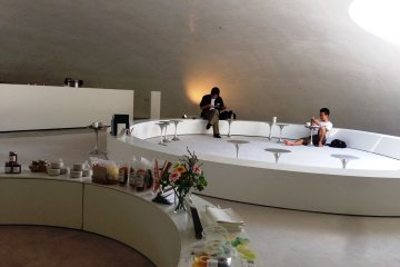Next to the artwork is a small museum shop and café that is shaped like the museum, where you can take off your shoes and relax on the carpeted floor