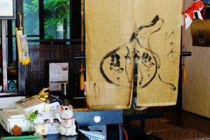 La caisse où un Maneki neko vous attend