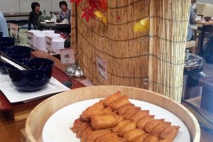 A fall display behind the inarizushi (fried tofu skin stuffed with vinegar rice)