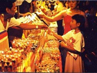 Little girl mesmerized by the shopkeeper