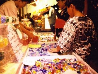 Young Yukata clad boy lost in a candy hued store