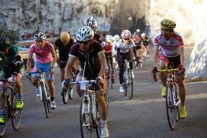 Riders battle their way up the steep Geki-zaka