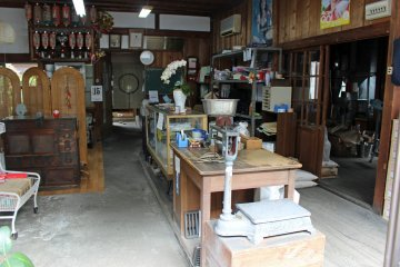 <p>A rice store with original furniture, scales and tools from days past</p>