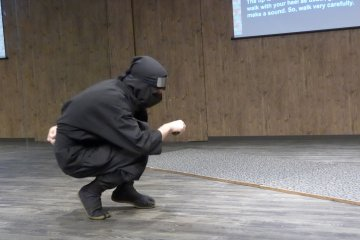 <p>The instructor demonstrates how to walk stealthily and silently.</p>
