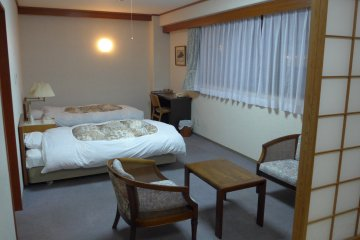 <p>The rooms are spacious and the one I stayed in came with comfortable Western-style beds.&nbsp;</p>