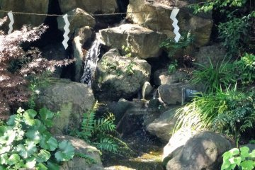 <p>A small waterfalls tumbles down the far bank</p>